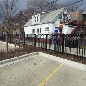 metal secure fencing concept for parking lot area for when looking up skilled fence contractors in Valparaiso