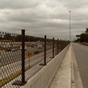 city street scene with chain link fence separating from highway, for fence installation in Tinley Park