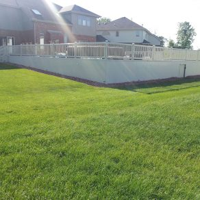 perimeter fencing around backyard pool area, contact reliable fence contractor in Valparaiso for your fencing options