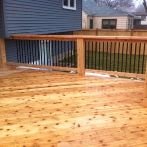 image of side railing of wood deck designed by Cedar Lake fence installation company