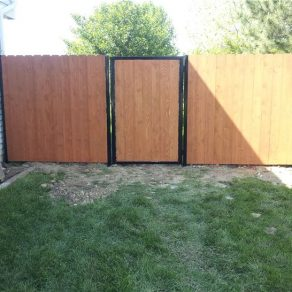 private wooden fence with gate image for when needing gate repair with Mokena fence company