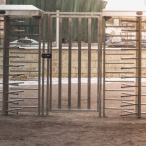 Turnstile gate with fencing, Stone like fencing with full privacy, if looking for affordable fence installers Lansing.