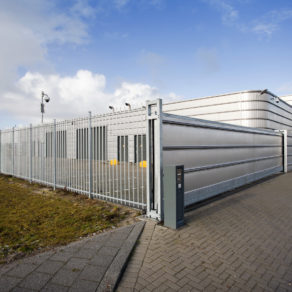 Industrial building with custom high security gate, if looking for affordable gate installers Lansing.