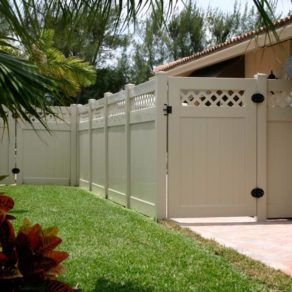An example of vinyl fence with tall gate, if looking for affordable fence installers Plainfield.
