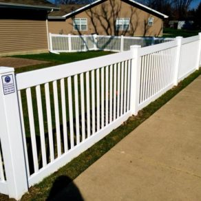A completed residential white plastic fence, if looking for affordable fence builders Merrillville.