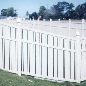 White plastic fence on a hill, if looking for affordable fence builders St. John IN.