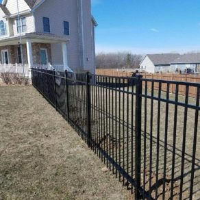 Black iron fence finished by good contractors, if looking for affordable fence builders Palos Heights.