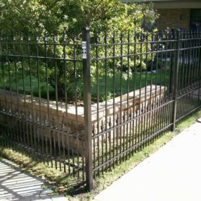Custom layered fence at business, if looking for affordable fence builders Oak Brook.