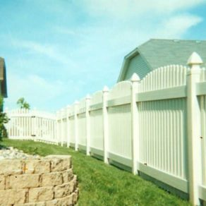 White no maintenance fence with curved top, if looking for affordable fence builders Tinley Park.