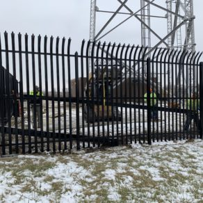 Dependable Munster fence service company at job site.