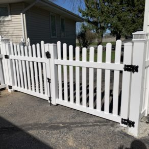 residential vinyl gate installed by quality Lowell fence company