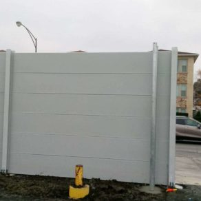Special cement fence protecting commercial space, for quality installation call on New Lenox fence repair.