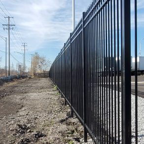 A photo of a black, iron fence representing how we install fences near Dyer.