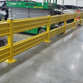 A row of cars in an industrial warehouse representing how we can help with Dyer fence contracting.
